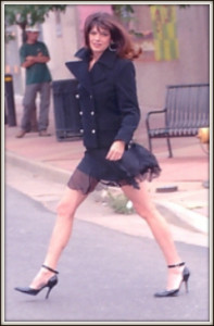 Maxine modeling pea coat and chiffon mini-skirt